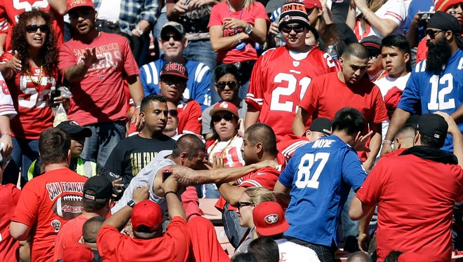 Fans scuffle in the stands during an NFL football game between the San Francisco 49ers and Indianapolis Colts at Candlestick Park.