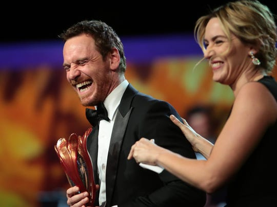 "Kate Winslet presents Michael Fassbender with the International Star Award for his performance in ""Steve Jobs."""