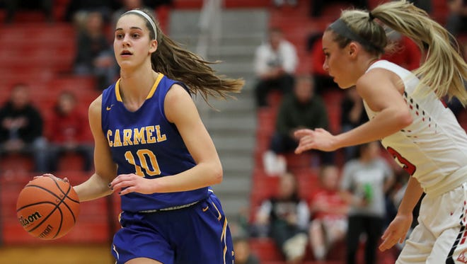 Amy Dilk (left) scored 20 points in Carmel's win over Center Grove on Friday night.