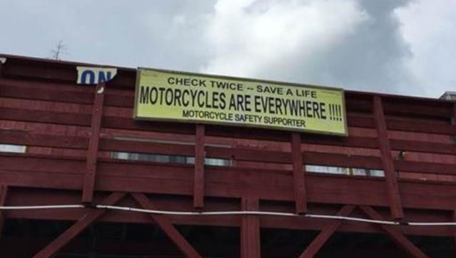 A motorcycle safety sign