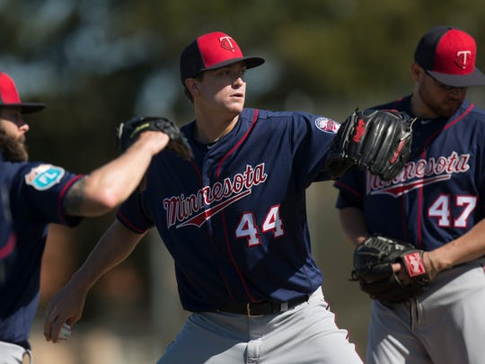 Minnesota Twins pitcher, Kyle Gibson practices with teammates during Spring Training on Monday.