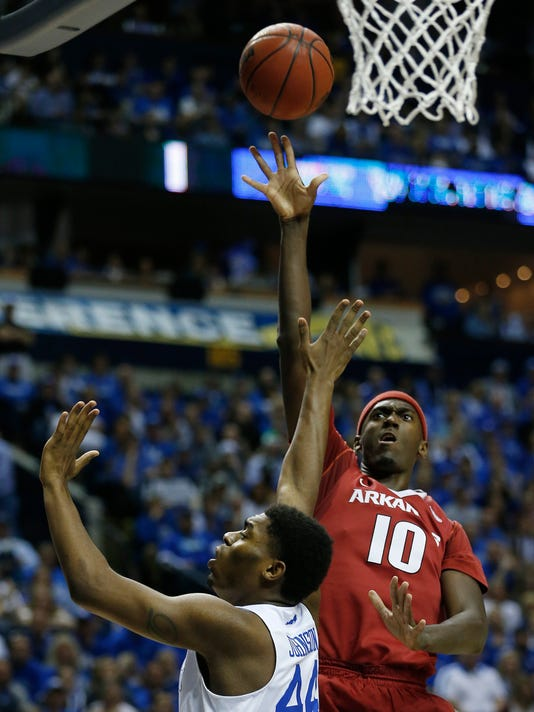 Arkansas forward Bobby Portis (10) shoots as Kentucky center Dakari Johnson (44) defends during the first half of the NCAA college basketball Southeastern Conference tournament championship game, Sunday, March 15, 2015, in Nashville, Tenn. (AP Photo/Steve Helber)