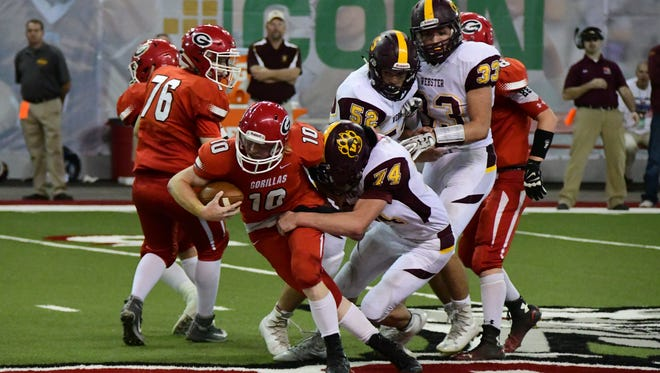 Gregory quarterback Andy McCance tries to break a tackle during last year's championship game at the DakotaDome.