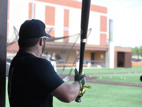 Argus Leader's Matt Zimmer prepares to bat during warm-ups