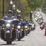 Hundreds of motorcyclists rumble into downtown Howell during the 2014 Ride to Remember