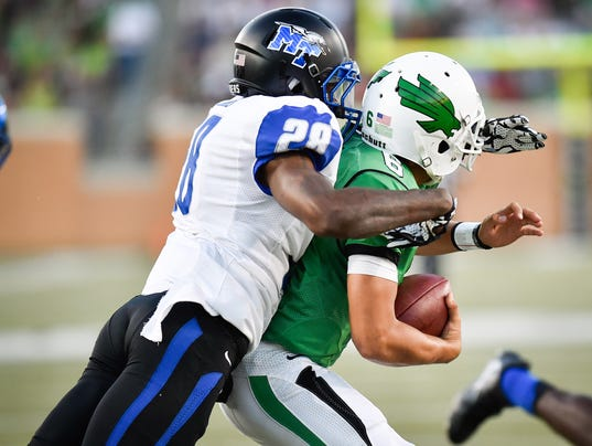 Middle Tennessee senior cornerback Dontavious Heard (28) sacks North Texas freshman quarter back Mason Fine  (6)