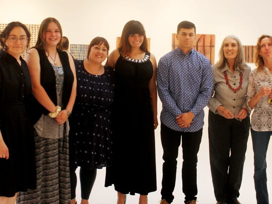 Graduating art students  Jennifer Castanon, from left, Chelsea Boone, Casney Tadeo, Dana K. Farr, Christopher Theulen, Carmen Ruiz, and Laurie Ford had their graduating Artist Exhibition opening Friday.