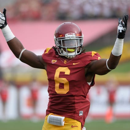 USC Trojans safety Josh Shaw (6) tries to get the crowd going during the third quarter of the Trojans 19-3 win over the Utah Utes at Los Angeles Memorial Coliseum.