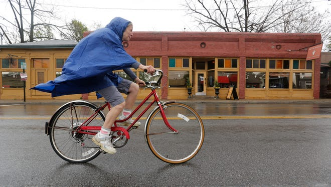 Despite the rain, Maria Pippenger came back to her old neighborhood to ride her bike along Frankfort Aveune during CycLouvia.  April 19, 2015.