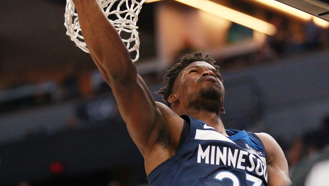 Minnesota Timberwolves guard forward Jimmy Butler (23) shoots against the Los Angeles Clippers in the first quarter of an NBA basketball game on Sunday, Dec. 3, 2017, in Minneapolis. (AP Photo/Andy Clayton-King)