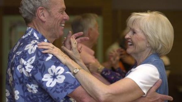 In 2002, winter visitors Hal Fisher and Iola Lee practiced their steps during a ballroom dancing class at the Mesa Senior Center East.
