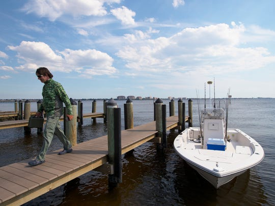 A boater arrives to the Cape Coral Yacht Club boat