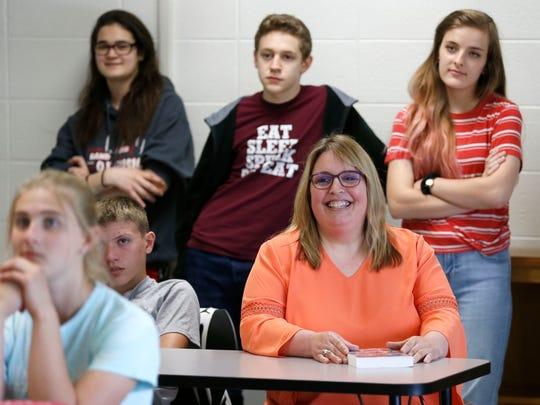 Ozark Junior High School teacher Natalie Houston listens to one of her favorite playwrights, Don Zolidis, speak to her class on Wednesday.