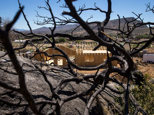 Residents are struggling to rebuild a year after the Yarnell Hill Fire. Chuck and Nina Bill Overmyer were hoping to be back into a new home by June 30, 2014, the anniversary of the fire. They just broke ground in May.