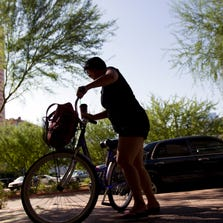 An international student at Arizona State University bikes to the downtown campus in October 2012. Foreign students pumped nearly $350 million into the Phoenix-area economy between 2008 and 2012.
