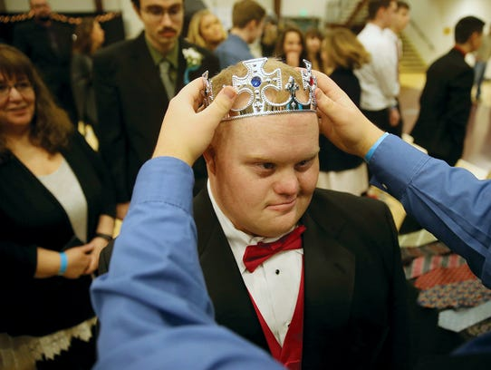 Matthew Caudill gets fitted with a crown at the Night