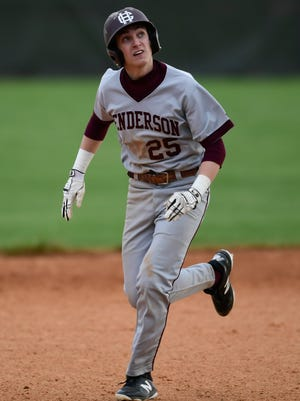 Henderson County's Jake Murdach (25) runs between second and third base during the game against the Union County Braves at Union County High School in Morganfield, Ky.,, Monday, April 9, 2018. The Colonels defeated the Braves, 6-1.