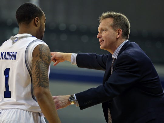 Drake head coach Ray Giacoletti gave instructions to Karl Madison in second half action against Indiana State in men's basketball game at the Drake Knapp Center in Des Moines on Wednesday night  Jan. 8, 2014.