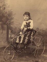 Little Girl on Fairy tricycle, ca. 1900. Collection of Lorne Shields.