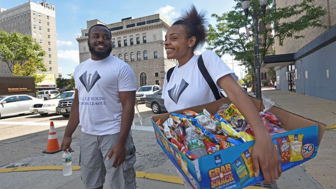 In between selling snacks,  Excite Youth Business League participant Ciara Stratton, 18, talks with mentor Evan Wheeler in Camden.