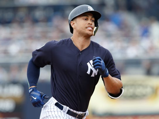 Yankees right fielder Giancarlo Stanton rounds the