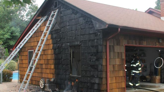 Firefighters extinguished a garage fire on Frazee Drive Wednesday.