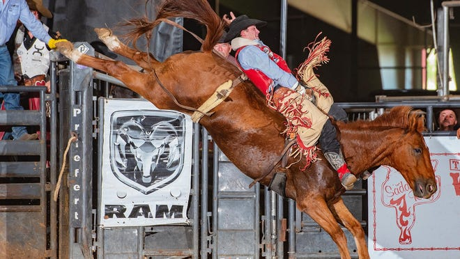 Paden Hurst from Huntsville competes in the Saddle Bronc Riding event during the 51st annual Cowboy Captial of the World Pro Rodeo, which completed its four-day run Sunday at Lone Star Arena in Stephenville.