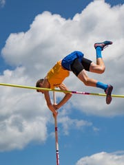 Dom Mikula of Trumansburg clears the pole vault bar in the early rounds of the 2017 New York State championships in Endicott.