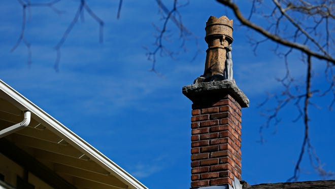 Rook-shaped chimneys and cat statues adorn this house on the 900 block of South Pickwick Avenue in Springfield.