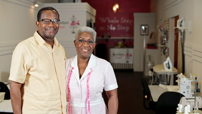 Owner Karen Williams poses with her husband, Kenny Williams, at Sewendipity Lounge on Main Street in downtown Cincinnati.