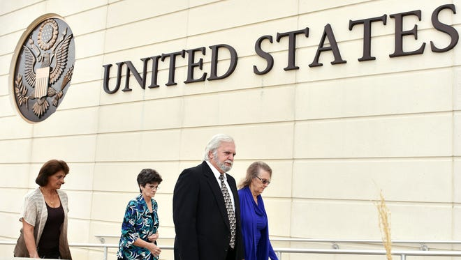Former Mississippi lawmaker and businessman Cecil McCrory, center, arrives at the United States Courthouse in Jackson Thursday morning for sentencing. In 2014 McCrory was formally charged in one of the largest corruption cases in Mississippi history.