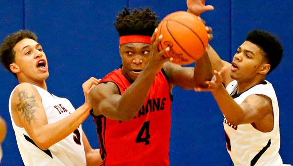 Reading's Lonnie Walker, center, is seen here in action