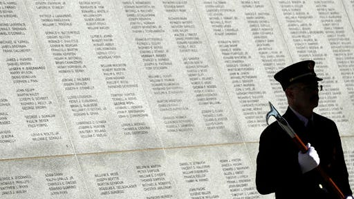 Christopher Taylor of the New York State Office of Fire Prevention and Control holds a pike pole during a ceremony at the New York State Fallen Firefighters Memorial at the Empire State Plaza on Tuesday, Oct. 11, 2016, in Albany, N.Y. In 2017, 118 names were added to the wall.
