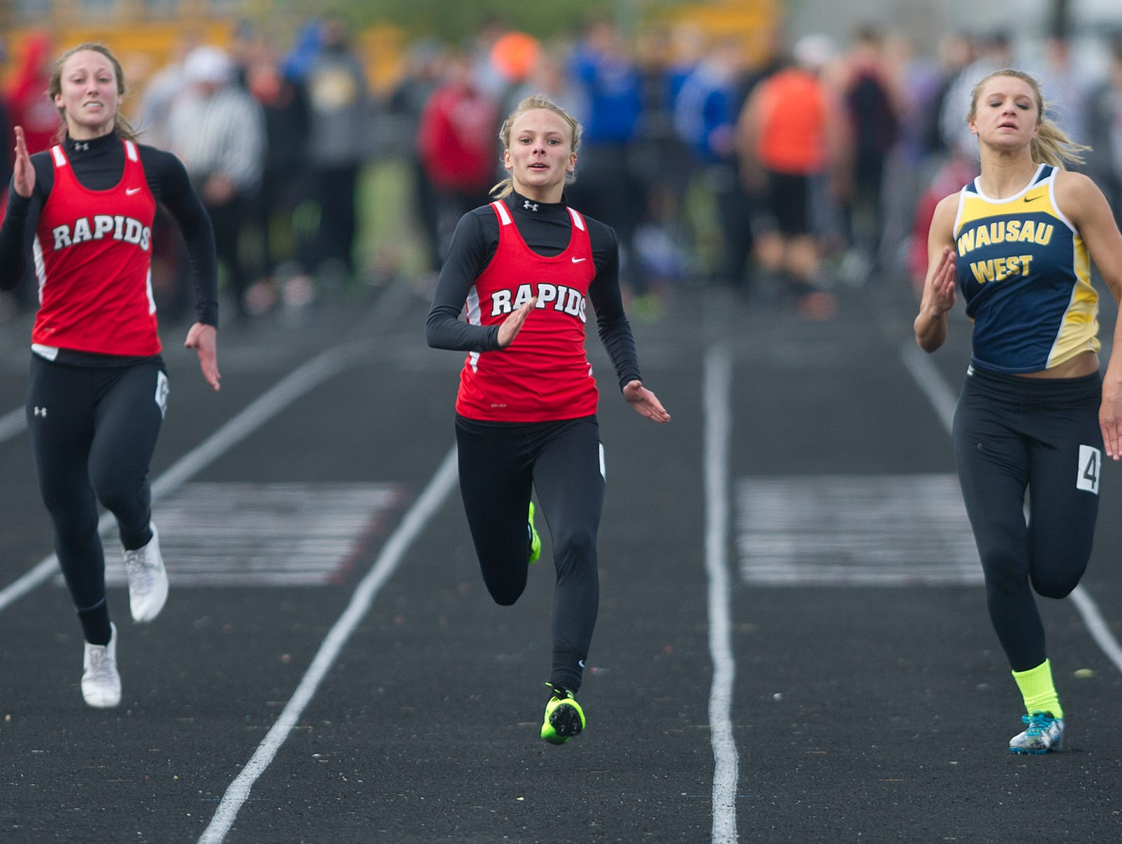From left, Wisconsin Rapids' Elizabeth Keena, teammate Grace Hartman, and Wausau West's Alyssa Faucett compete in the 100 meter dash during the Wisconsin Valley Conference Track Meet at South Wood County Field in Wisconsin Rapids, Tuesday, May 19, 2015.