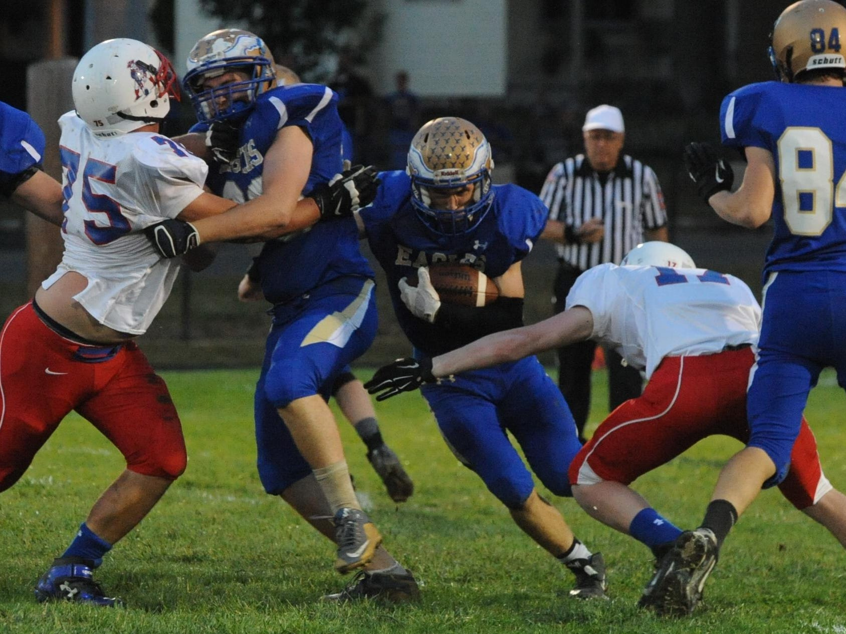 Lincoln's Ben Bertsch looks for running room against Union County during Friday's game in Cambridge City.
