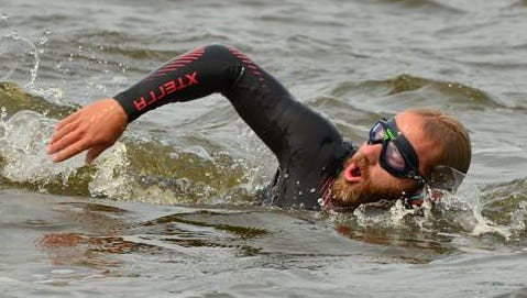Father Ryan grad Chris Ring, a Navy combat veteran, during his swim down the Mississippi River.