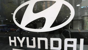 In this Oct. 26, 2016, photo, the logo of Hyundai Motor Co. is displayed at the automaker's showroom in Seoul, South Korea.