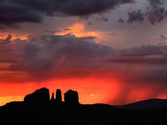 A monsoon storm adds drama to a Sedona sunset.