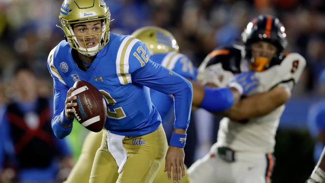 UCLA quarterback Austin Burton (12) runs out of the pocket against Oregon State during the first half of an NCAA college football game Saturday, Oct. 5, 2019, in Pasadena, Calif. (AP Photo/Marcio Jose Sanchez)