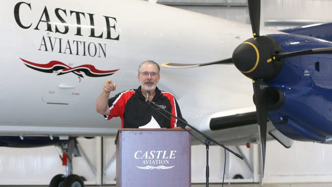 Michael Grossmann, president and owner of Castle Aviation, makes remarks during the grand opening of a hangar next to the renovated former 356th Fighter Group restaurant at Akron-Canton Airport.