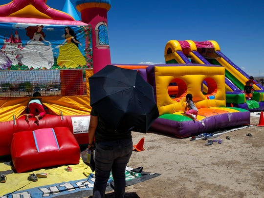 Children play on the inflatable jump houses Monday during the  Summer Celebration event hosted by the Shiprock Office of Diné Youth.