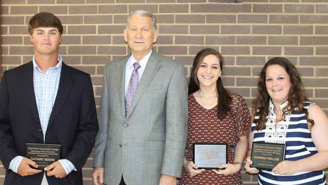 William Lewis, second from left, president of Pearl River Community College, presented plaques to scholarship recipients during Awards Day on April 26. They are, from left, Zachary Boone of Sandy Hook, who received the Mississippi State University Presidential Partnership Scholarship; Leah Balli of Carriere and Hannah Miller of Poplarville, recipients of the Presidential Scholarship Award for the University of Southern Mississippi. Not pictured is Mallory Benoit of Poplarville, recipient of the MSU scholarship.