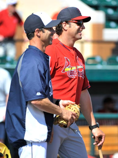 New Tigers manager Brad Ausmus, left, talks with Cardinals