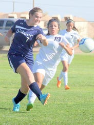 Silver's Megan Waters boots this ball during action
