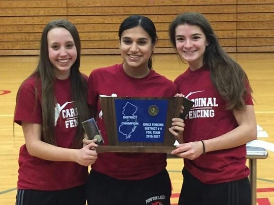 The Pompton Lakes girls foil team of Kelly Minard, left, Sana Malik, center, and Jenna Waibel finished in first place to advance to the state squad championships on Feb. 25 at North Hunterdon High School.
