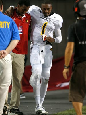 Grambling State quarterback DeVante Kincade (1) limps to the bench during the second half of an NCAA college football game against Arizona, Saturday, Sept. 10, 2016, in Tucson, Ariz. Arizona defeated Grambling State 31-21. (AP Photo/Rick Scuteri)