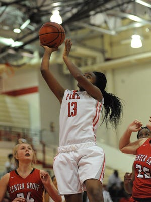 Eniya Madden puts up a shot in Pike's 56-49 win over Center Grove on Saturday.