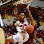 UL point guard Jay Wright works under the basket during Saturday night's win over Troy at the Cajundome.