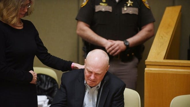 Defense attorney Lucy Karl comforts Robert Dellinger after testimony by the families of Amanda Murphy and Jason Timmons, who were killed in 2013 in an accident caused by Dellinger, during Robert Dellinger's sentencing at the Grafton County Superior Court in North Haverhill, N.H., on Wednesday, April 1, 2015. The former Fortune 500 executive who admitted causing a highway crash that killed a Vermont couple and their unborn fetus told a judge on Wednesday that he wasn't suicidal at the time of the crash.
