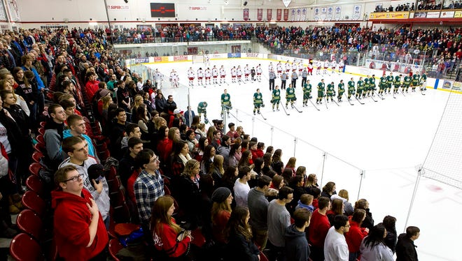 Fans and players stand during the national anthem at Ronald B. Stafford Ice Arena, prior to the start of the Plattsburgh State-Oswego game in Plattsburgh, N.Y., on Feb. 5.